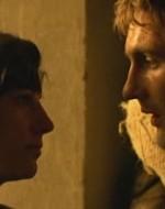 Una volta dentro, incrocia una giovane contadina. Le va vicinissimo e la bacia sulla bocca con leggerezza. Nessuno dei due chiude gli occhi. Olmo ha ancora il sacco sulle spalle.  //  ANITA: Tu devi essere Olmo.  //  OLMO: E tu chi sei?  // ANITA: Mi chiamo Anita Furlan. //  OLMO (studiandola con l'occhio del conoscitore): Veneta, eh?  Sei profuga?   //  ANITA: Sì. Ho perso tutta la famiglia.